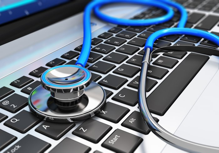 Stethoscope On Laptop Keyboard Service